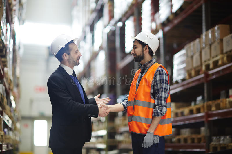 Greeting worker royalty free stock images