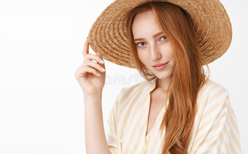 Greetings cutie. Portrait of stylish mysterious and sensual beautiful redhead woman smiling flirty gazing at camera with stock image