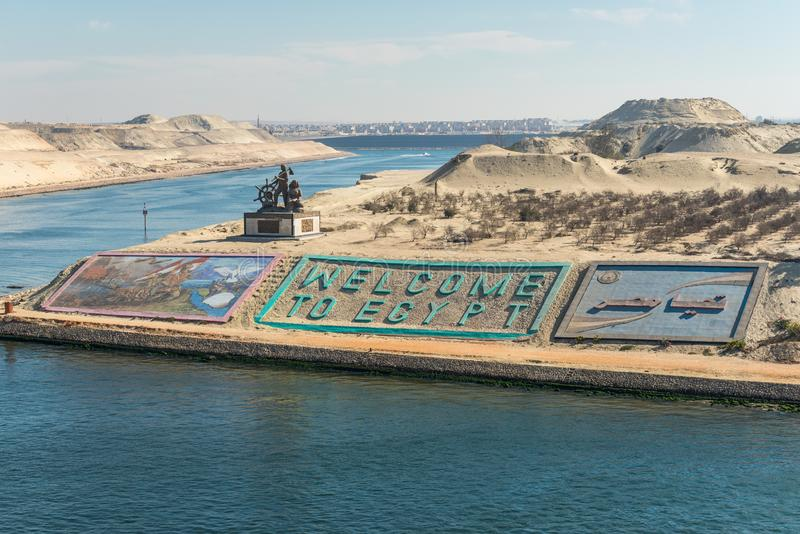 Greetings in Egypt at new Suez Canal in Ismailia, Egypt. Ismailia, Egypt - November 5, 2017: Suez canal authority monument and gigantic letters saying `welcome royalty free stock photography