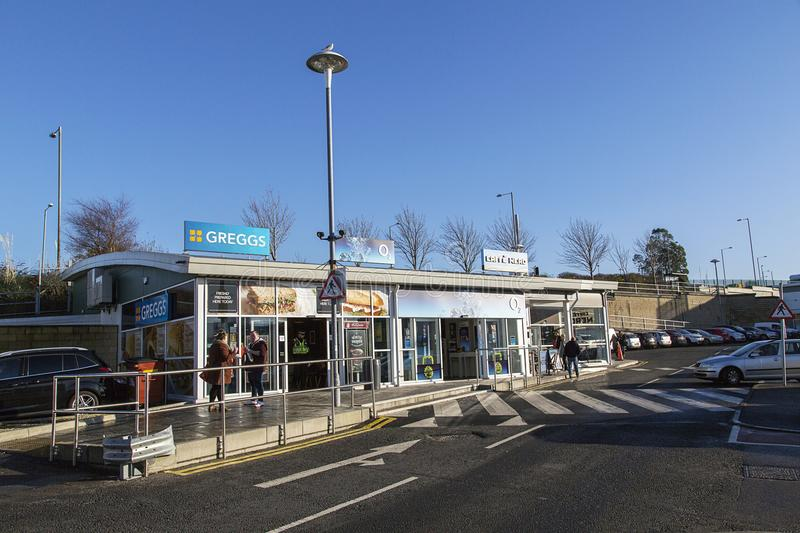 Greggs Bakery with customers eating pastries outside on a sunny day royalty free stock photo