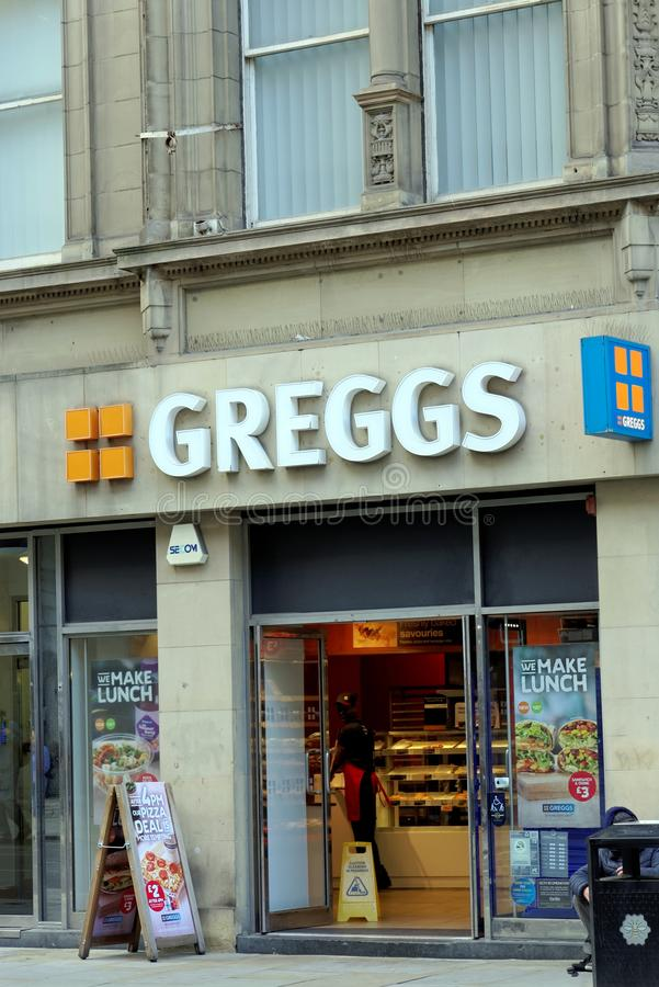 Greggs in the city of Manchester, the largest bakery chain in the United Kingdom. MANCHESTER, UK - AUGUST 10, 2018: Greggs sign over premises, largest bakery stock photography