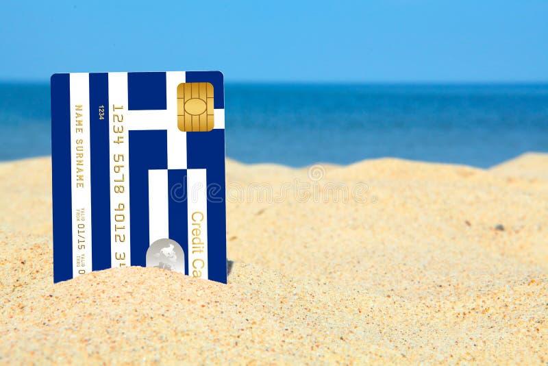 Grekisk kreditkort på stranden royaltyfri fotografi