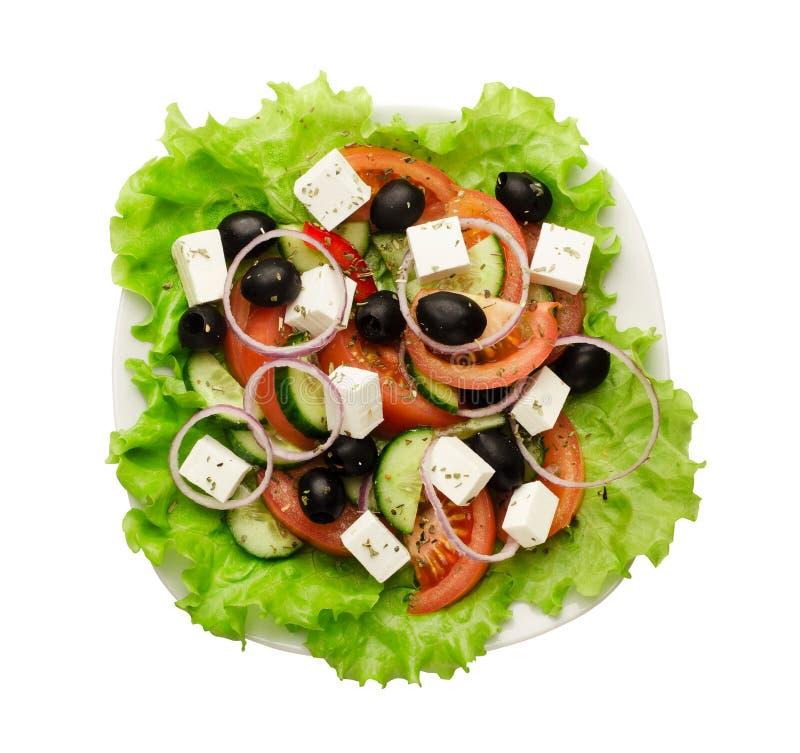 Grekisk sallad av den nya gurkan, tomaten, söt peppar, grönsallat, den röda löken, fetaost och oliv med olivolja royaltyfri foto