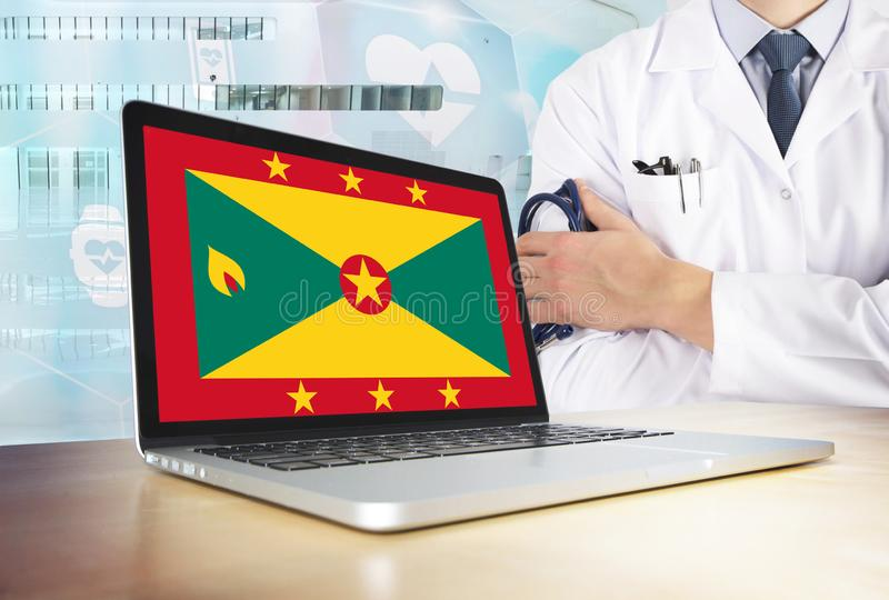 Grenada healthcare system in tech theme. Grenadian flag on computer screen. Doctor standing with stethoscope in hospital. Cryptocurrency and Blockchain concept stock images