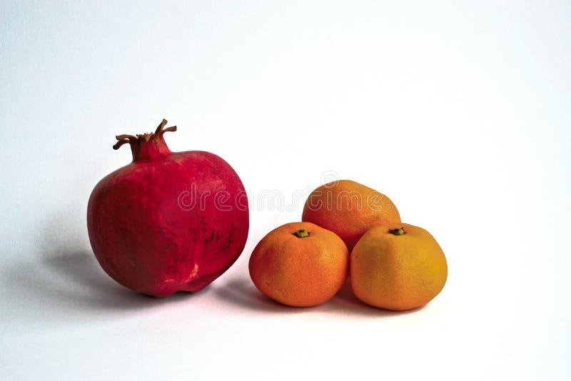 Grenade et mandarines images stock
