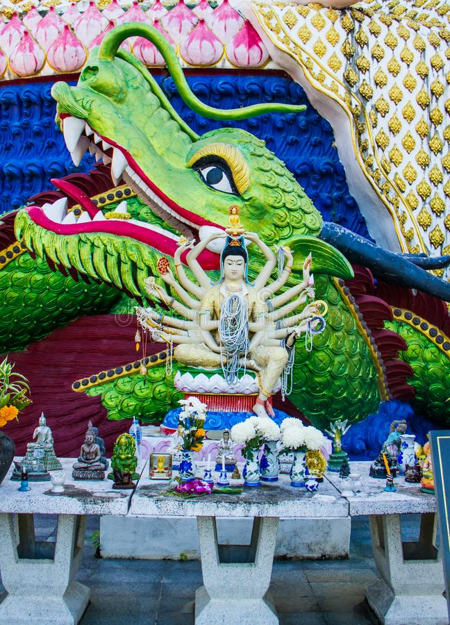 Grenn dragon with Guanyin statues. In temple at Koh Samui,Thailand stock photos
