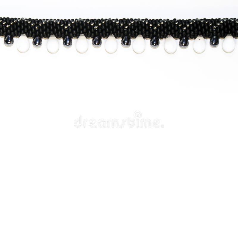 Grens van zwarte luxueuze geparelde juwelen met kristallen in FO royalty-vrije stock afbeelding