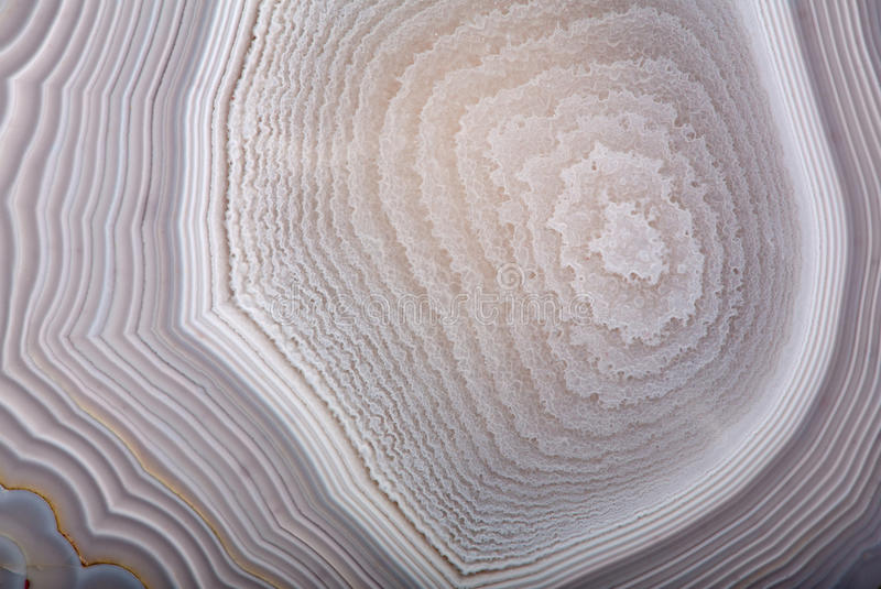 Grey agate structure background. Background with grey agate structure stock images