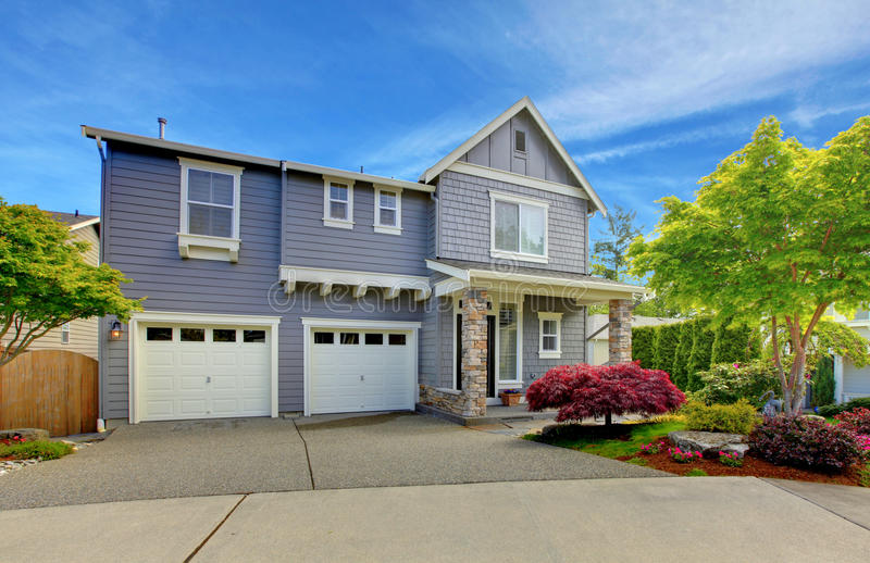 Grey American house with two garage doors. stock photography