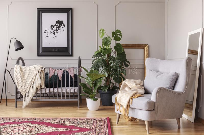 Grey armchair in baby`s bedroom interior. Real photo royalty free stock photos