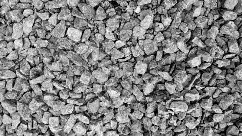 Grey asphalt stone texture background. Building small stone gravel. Road texture royalty free stock image