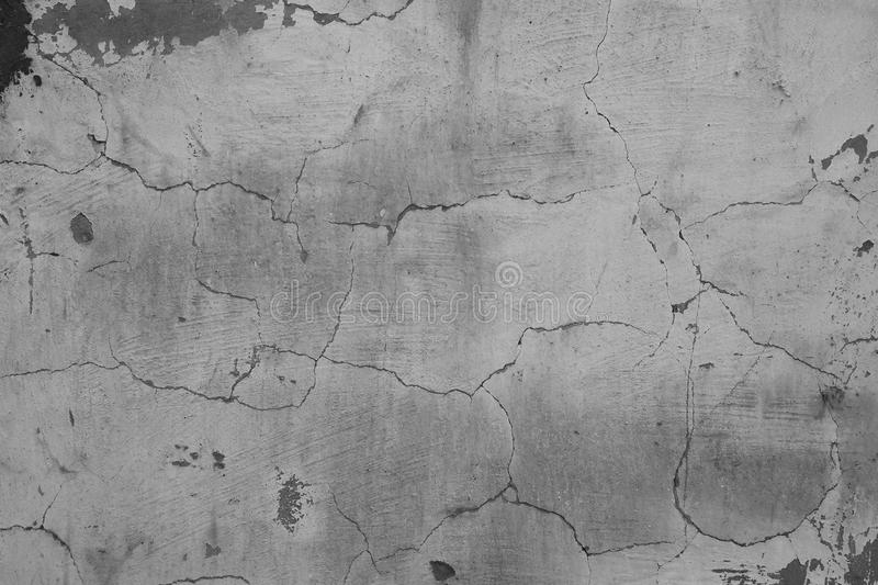Grey background wall cracked texture. Surface stock photo