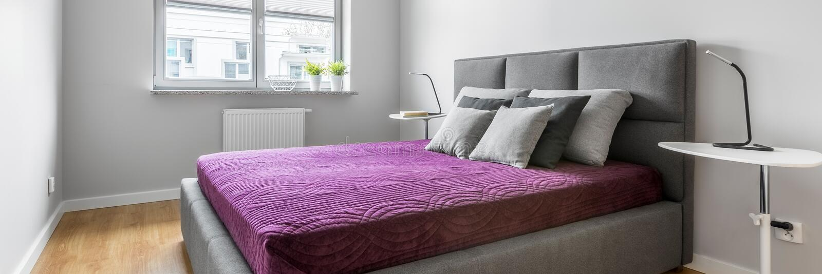 Grey bedroom with double bed, panorama stock photos