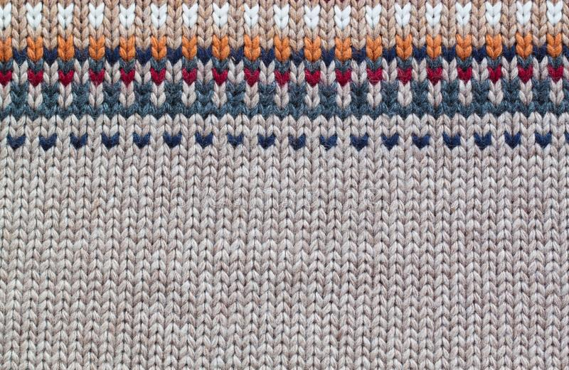 Grey and beige realistic knitting pattern. Wool royalty free stock image