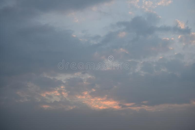 A grey and blue pastel coloured clouded sunset sky stock photo