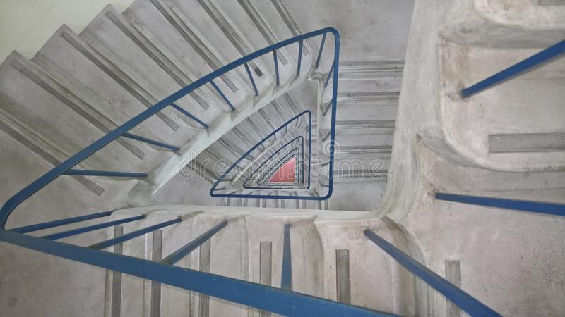 Grey And Blue Spiral Stair Case Painting stock photography