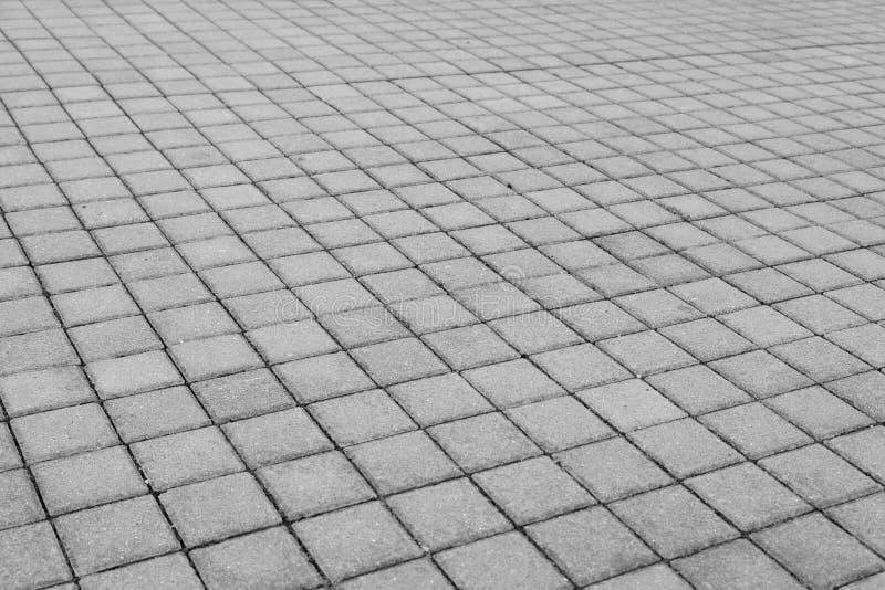 Grey brick stone street road. Light sidewalk, pavement texture. For website stock photography