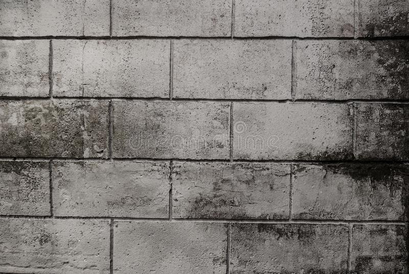 Grey brick wall, brickwork background of dark stone textured for design. Old vintage concrete block wall texture for pattern and royalty free stock photos