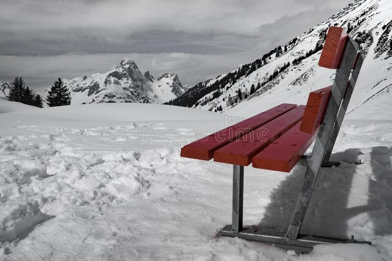 Grey and Brown Bench on Snow Near Mountain during Daytime royalty free stock photos