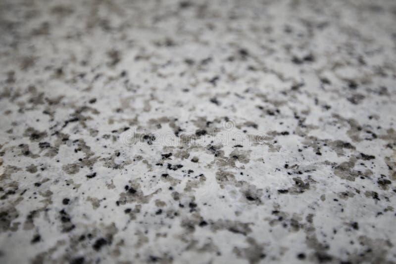 Grey, Brown, And Black Granite stock images