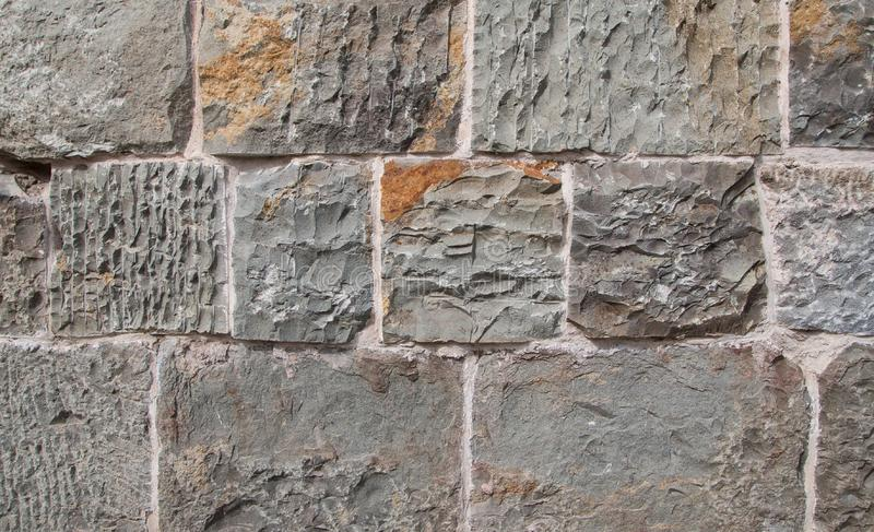 Grey and brown concrete block cobble stone texture pattern background stock photos