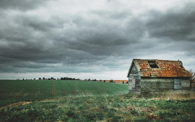 Grey and Brown House Near Green Grass Field stock photos