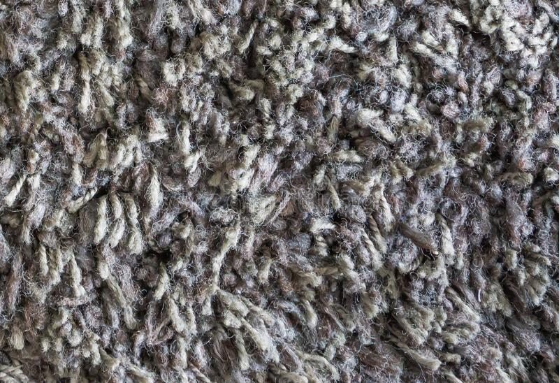 Grey brown wool floor carpet close up macro background texture stock photography