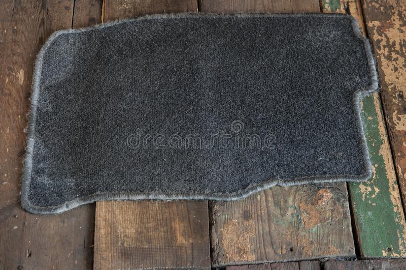 Grey carpet on the wooden floor stock photos