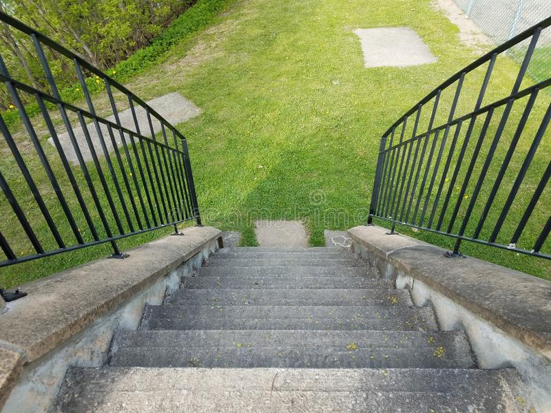 Grey cement steps or stairs with railing stock photography