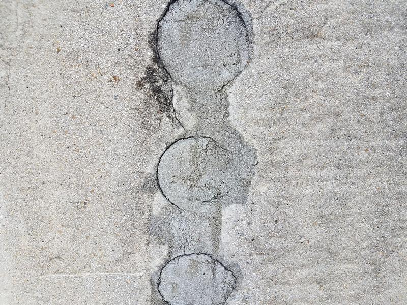Grey cement wall with circular hole filled. Or repaired royalty free stock photos