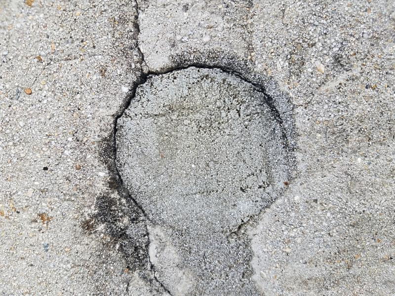 Grey cement wall with circular hole filled. Or repaired stock photos