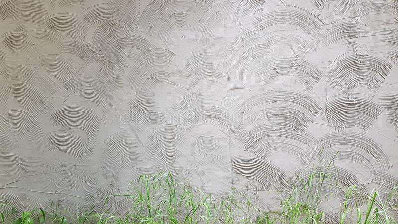 Grey cement wall plastering with circle geometric wave pattern stock image