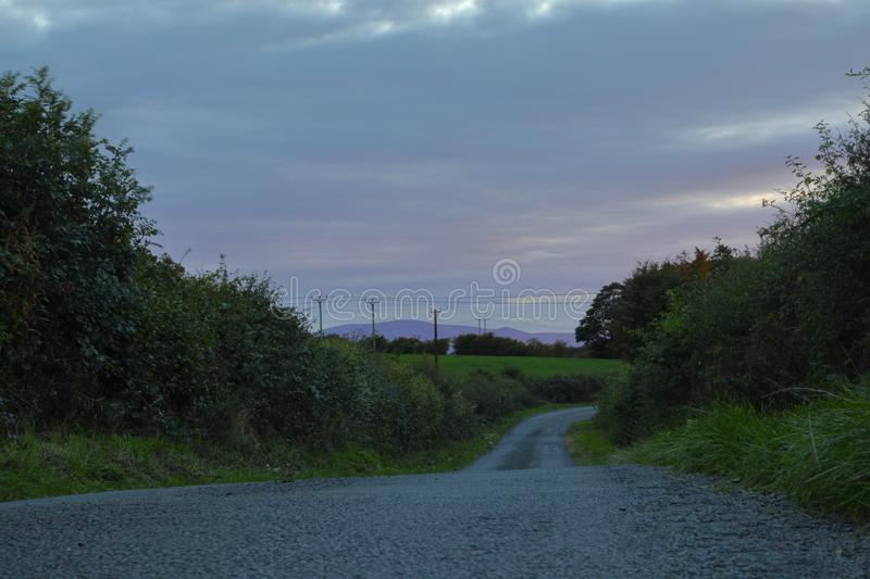 Grey clouds above the road royalty free stock photo
