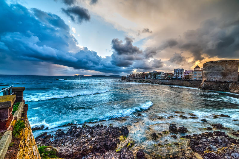 Grey clouds over Alghero at sunset. Sardinia stock photography