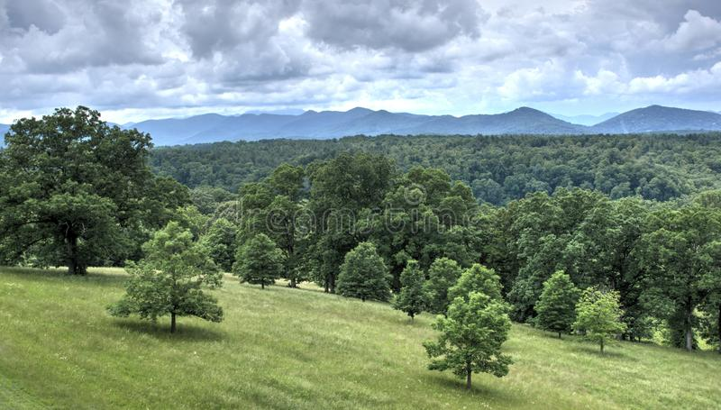 Rain Clouds over Pisgah Mountains, Biltmore Estate. Grey clouds over Pisgah National Forest mountains photographed from the back patio of the Biltmore Estate royalty free stock images