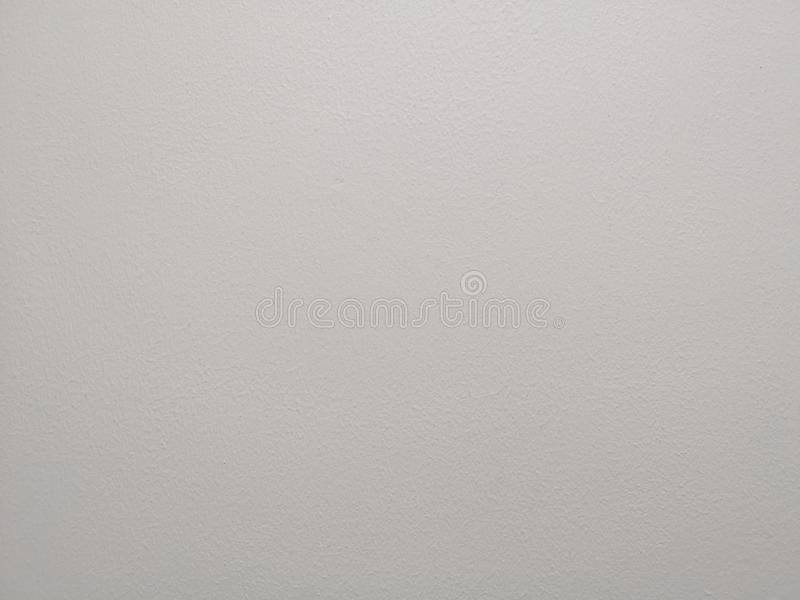 Grey color painting of polished surface on concrete plastering background royalty free stock photography