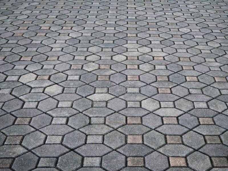 Grey Concrete Paving Blocks in het Stadspark stock foto's