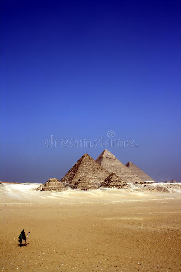 Grey Concrete Pyramids on the Middle of the Dessert during Daytime stock images