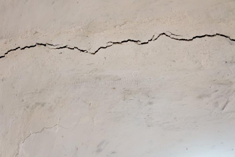 Grey cracked background. Grey cracked concrete texture background stock photography