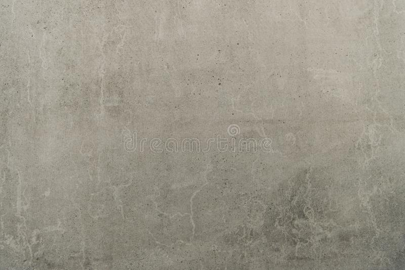 Grey cracked texture. Close-up view of old blank grey cracked texture stock photography