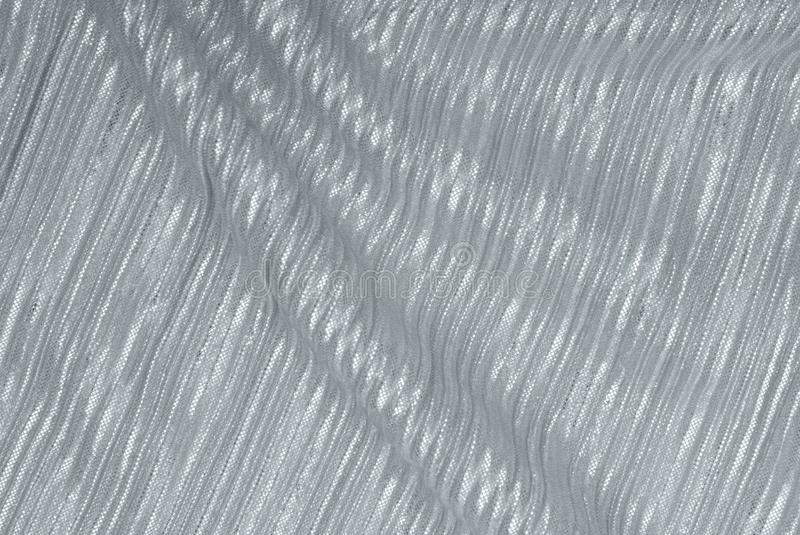 Grey drapery fabric, textured backgrounds has silvery color royalty free stock photo