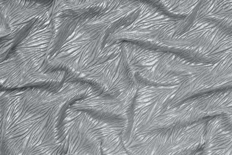 Grey drapery fabric, textured backgrounds has silvery colour stock photography