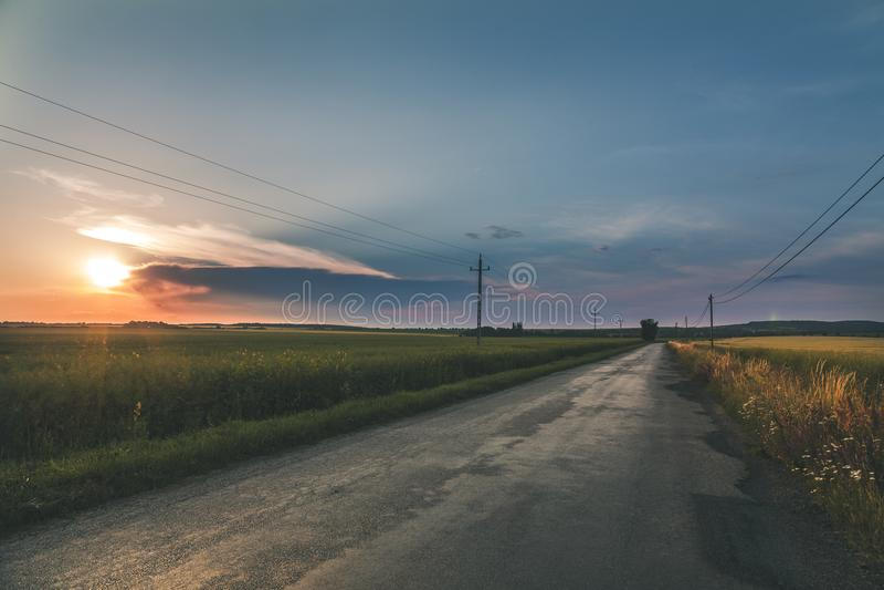 Grey Empty Road Between fields stock photos