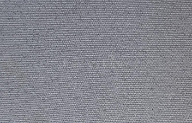Grey Fabric mit Flecken lizenzfreie stockbilder