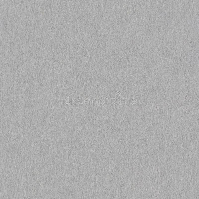 Grey felt material as a background. Seamless square texture, tile ready. stock image
