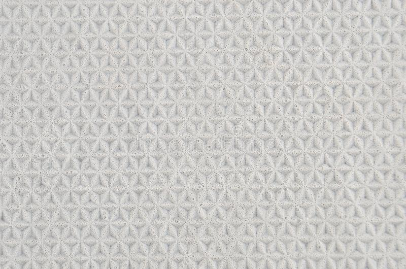 Grey foamed rubber. Close up as background stock image