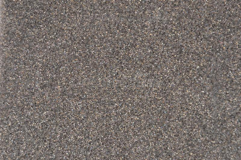 Grey foamed rubber. Close up as background royalty free stock photo