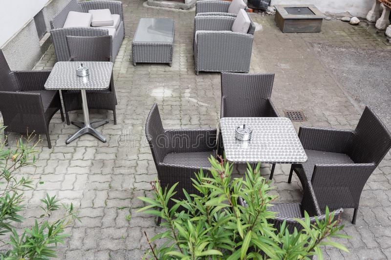 Grey garden furniture with flowers in pots on terrace of spacious hotel Vienna, Austria royalty free stock images