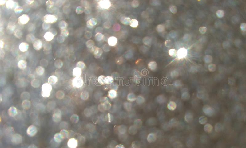Grey glitter textured background,Bright beautiful shining grey glitter. Grey glitter textured background. Bright beautiful shining grey glitter.many uses for stock images