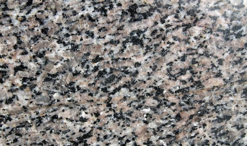 Grey gray granite rock polished surface royalty free stock images